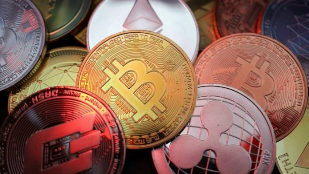 Picture of various crypto coins laying atop one another